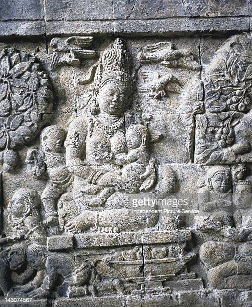 Hindu relief depicting a mother and children located on the Candi Mendut Java Indonesia