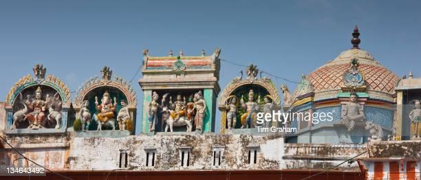 Hindu religious icons above Hindu Temple at Kedar Ghat during Festival of Shivaratri in holy city of Varanasi Northern India