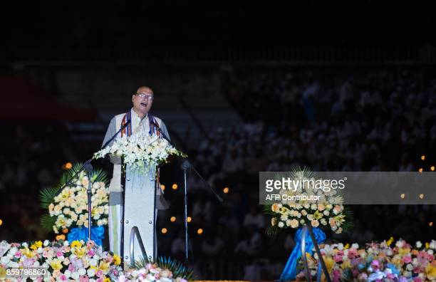 Hindu religious leader Hla Tun delivers a speech during the Interreligious Gathering of Prayer for Peace ceremony in Yangon on October 10 2017 Tens...
