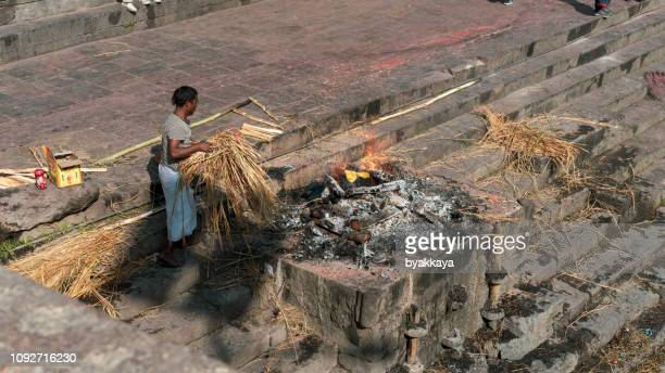 hindu ritual of cremation in the pashupatinath temple. - crematorium stock pictures, royalty-free photos & images
