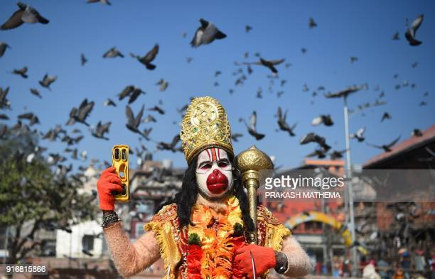 Hindu Sadhu dressed as Hanuman the monkey god poses ahead for a picture ahead of the forthcoming Hindu festival of 'Maha Shivaratri' at the...