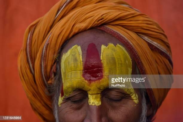 Hindu Sadhu or Holy Man applies colors on his face at the premises of Pashupatinath Temple during the celebration of Maha Shivaratri Festival at...