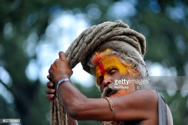 A Hindu Sadhu or Holy Man arrange his long hair at the the premises of Pashupatinath Temple Kathmandu Nepal on Wednesday June 28 2017 Pashupatinath...