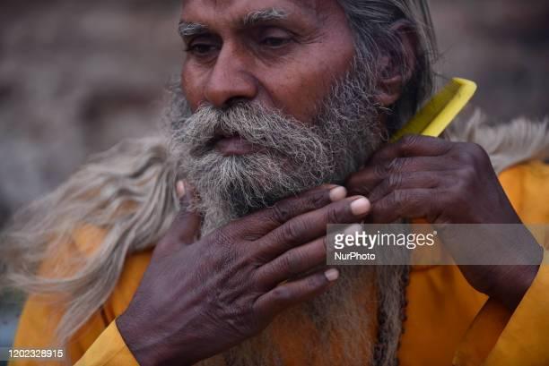 A Hindu Sadhu or Holy Man comb beard during Maha Shivaratri at the premises of Pashupatinath Temple Kathmandu Nepal on Friday February 21 2020...