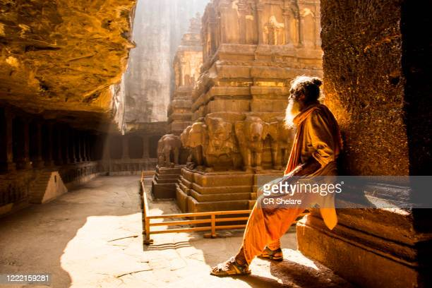 hindu sadhu the holy men in front of kailasa temple, ellora caves, unesco world heritage side. - ellora stock pictures, royalty-free photos & images