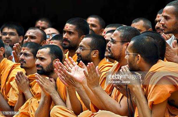 Hindu saints of the Swaminarayan religion engaged in the prayers and the singing of hymns. Swaminarayan is one of the major Hindu sects of India, the...