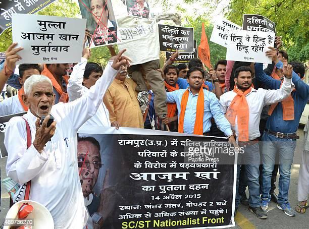 Hindu Sena activist protest and burn effigy of Azam Khan Samajwadi party leader and Uttar Pradeshs minister at Jantar Mantar against Dalit community...