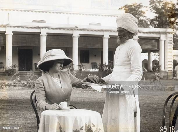 Hindu servant serving tea to a European colonial woman Undated photograph BPA#2 4362