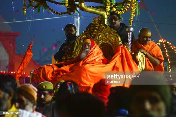 Hindu Shankaracharya Swami Swaroopanand Saraswati sits on his silver chariot as he arrives to take part in Kumbh Mela Allahabad on January 23 2019