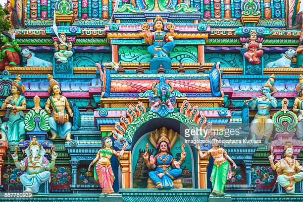 Hindu temple decorated with gods on outskirts