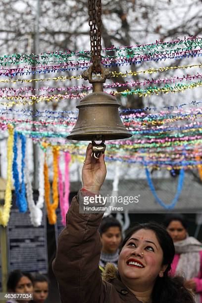 Hindu woman devotee ringing the bells at the historic Shankaracharaya temple on the occasion of Mahashivratri festival on February 17 2015 in...