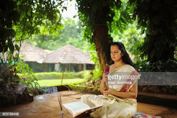 hindu woman in meditation - chanting stock pictures, royalty-free photos & images