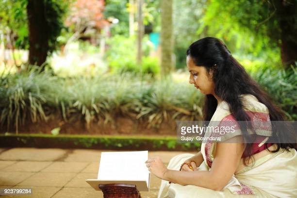Hindu Woman Reading Religious Book