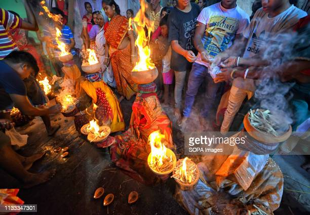 Hindu women are seen seated with burning fire pots on their head as a Traditional ritual of worshipping Devi Sheetala As per Hindu mythology Devi...