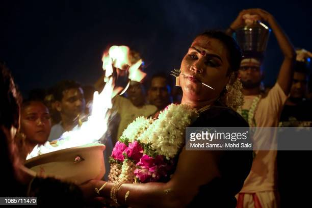 Hindu women carries a firepot as she perform a prayer at Batu Caves temple during Thaipusam festivals on January 21 2019 outside Kuala Lumpur...