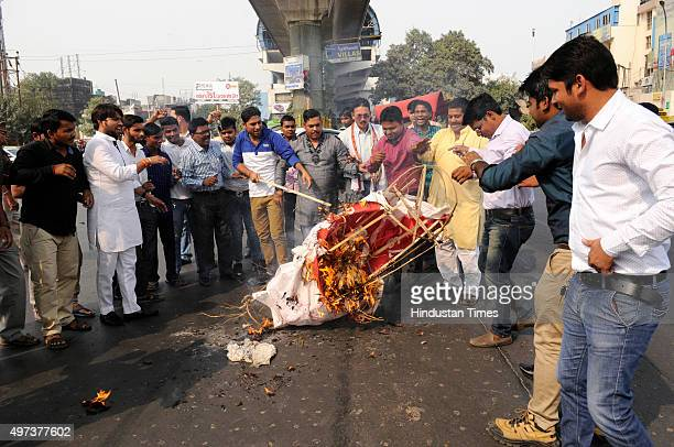 Hindu Yuva Vahini activists burn an effigy representing terrorism during their protest against global terrorism and Paris terror attacks on November...