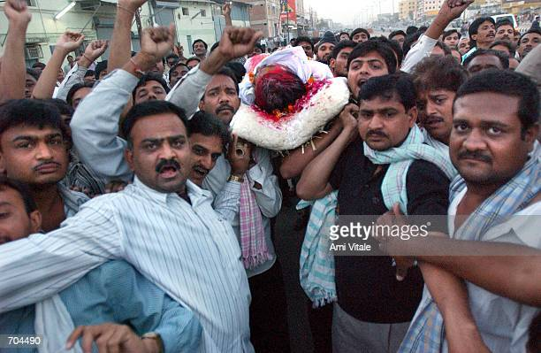 Hindus carry the body of a man killed in the clashes between Hindus and Muslims March 2 2002 in Ahmadabad India Troops arrived in Indias riottorn...