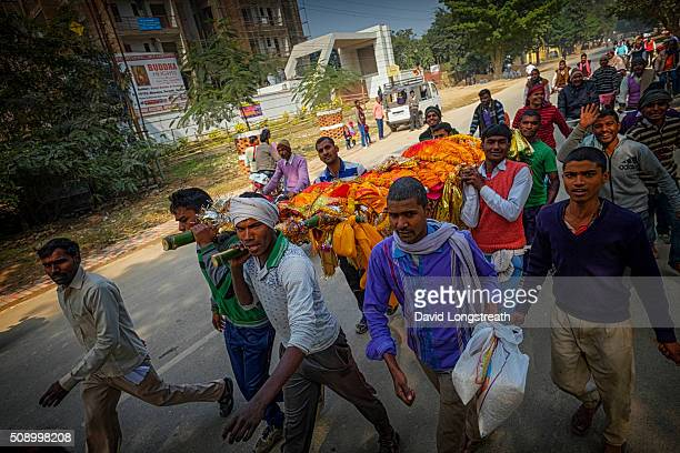 Hindus carry the body of man during a funeral procession towards the Ganges river Hindus consider the river sacred and to be cremated on its banks a...