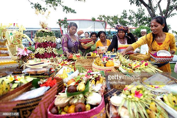 Hindus devotees carry offerings during the Melasti ritual ceremony at Shooting Venue Jakabaring Sport City The Melasti is a ceremonial turnover time...