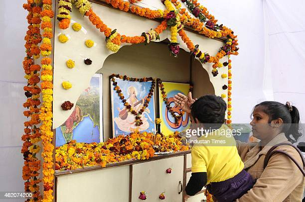 Hindus devotees offer prayers infront of the idol of goddess Saraswati during a Vasant Panchami festival on January 24 2015 in Noida India Vasant...