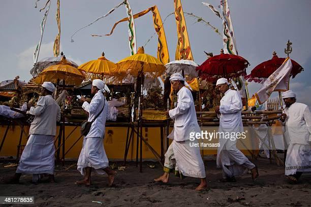 Hindus devotees pray during the Melasti ritual ceremony at Parangkusumo beach on March 28 2014 in Yogyakarta IndonesiaThe Melasti ritual is held...
