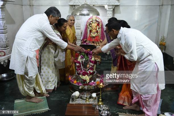 Hindus offer lotus flowers on the 'Shree Pranav Pardeshwar Mahadev' a Shiva linga made of solidified mercury to mark the Hindu festival 'Maha...