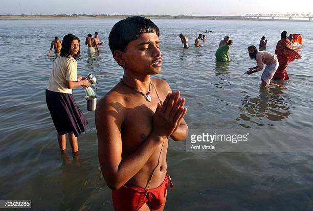 Hindus pray to Lord Shiva at the Saruj river in the northern Indian city of Ayodhya at sunrise on the Hindu festival day of Shivratri March 12, 2002...
