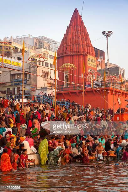 Hindus praying and bathing in Ganges