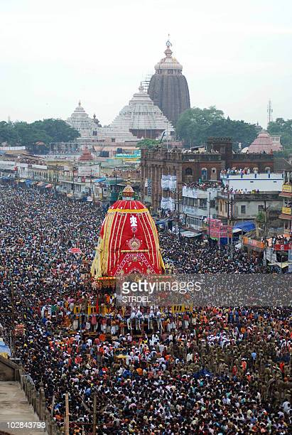 Hindus pull a Lord Jagannath chariot through a crowd of devotees during Rath Yatra celebrations in the coastal city of Puri about 65 km from Orissa...