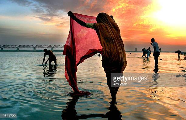 Hindus wash themselves after praying to Lord Shiva at the Saruj river in the northern Indian city of Ayodhya at sunrise on the Hindu festival day of...