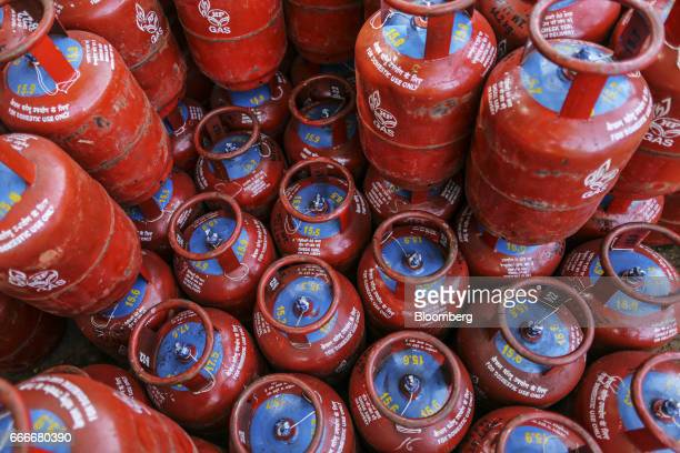 Hindustan Petroleum Corp liquefied petroleum gas cylinders sit stacked at a depot operated by the company in Mumbai India on Saturday April 8 2017...