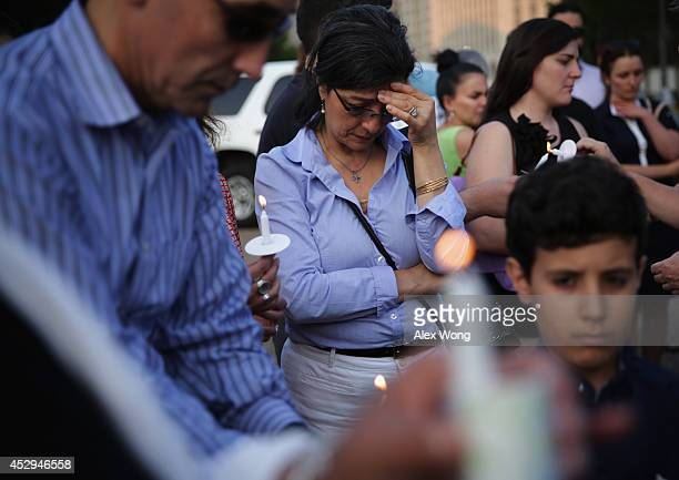 Hindy Mokhiber of Reston Virginia whose family was from Palestine participates in a candlelight vigil in front of the White House July 30 2014 in...