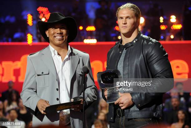 Hines Ward and Clay Matthews speak on stage at the 2011 CMT Music Awards at the Bridgestone Arena on June 8 2011 in Nashville Tennessee
