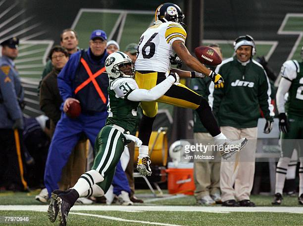 Hines Ward of the Pittsburgh Steelers can't hold onto a pass as he is defended by Hank Poteat of the New York Jets at Giants Stadium November 18 2007...