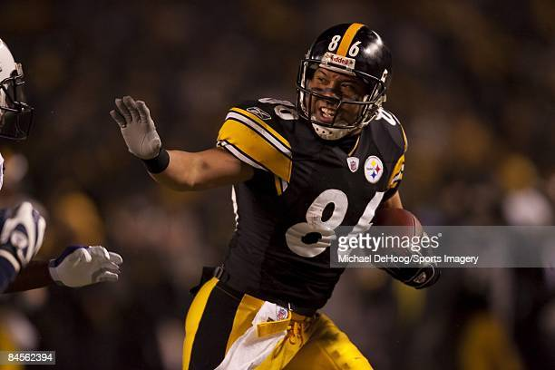 Hines Ward of the Pittsburgh Steelers carries the ball after catching a pass against the San Diego Chargers during a AFC Divisional Playoff Game on...
