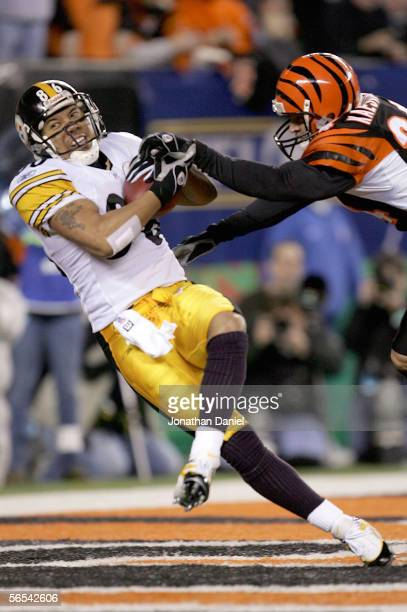 Hines Ward of the Pittsburgh Steelers catches a touchdown pass against Kevin Kaesviharn of the Cincinnati Bengals during the second quarter of the...
