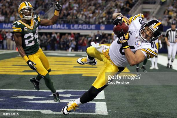 Hines Ward of the Pittsburgh Steelers catches an eight yard touchdown pass in the second quarter against the Green Bay Packers in Super Bowl XLV at...