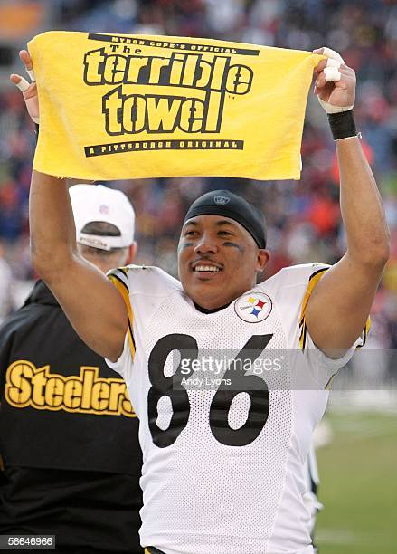Hines Ward of the Pittsburgh Steelers holds up a terrible towel in celebration in the final minute of the Steelers' 34-17 win over the Denver Broncos...