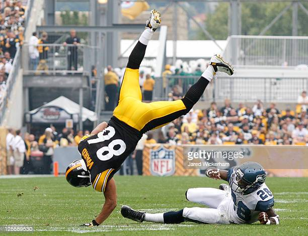 Hines Ward of the Pittsburgh Steelers is flipped over Walter Thurmond of the Seattle Seahawks after catching a pass in the first half during the game...