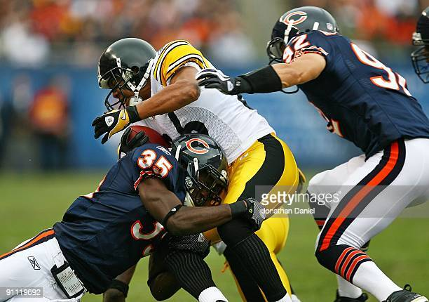 Hines Ward of the Pittsburgh Steelers is tackled by Zackary Bowman of the Chicago Bears as teammate Hunter Hillenmeyer closes in on September 20 2009...