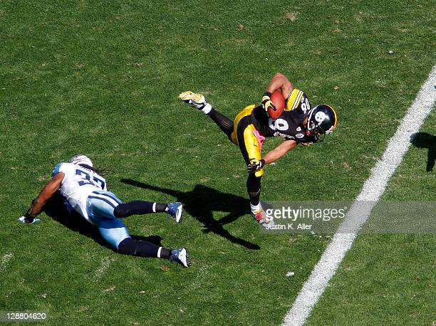 Hines Ward of the Pittsburgh Steelers runs after the catch and scores a touchdown against Tommie Campbell of the Tennessee Titans during the game on...