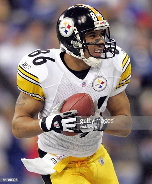 Hines Ward of the Pittsburgh Steelers runs for a touchdown after a reception against the Indianapolis Colts in NFL action November 28 2005 at the RCA...