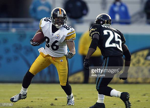 Hines Ward of the Pittsburgh Steelers runs with the ball against Fernando Bryant of the Jacksonville Jaguars during the NFL game on December 1 2002...