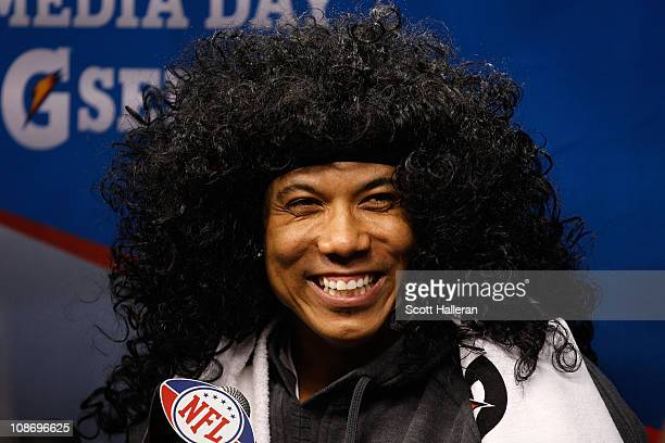 Hines Ward of the Pittsburgh Steelers smiles as he wears a Troy Polamalu wig as he is on the podium during Super Bowl XLV Media Day ahead of Super...