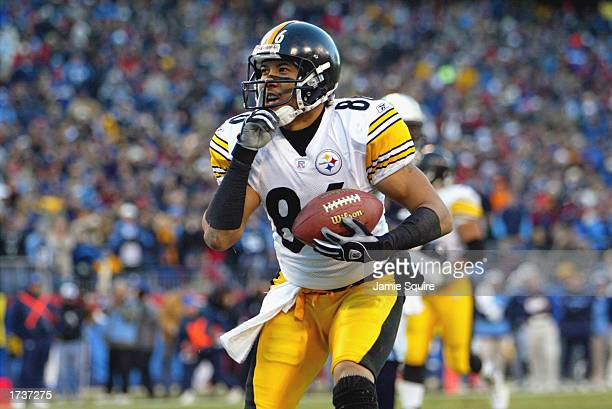 Hines Ward of the Pittsburgh Steelers taunts the crowd after catching a touchdown pass against the Tennessee Titans during the AFC divisional playoff...