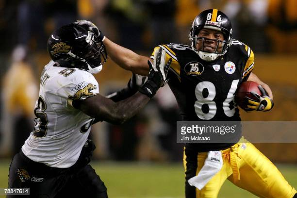 Hines Ward of the Pittsburgh Steelers tries to shake off Justin Durant of the Jacksonville Jaguars during the AFC Wild Card game on January 5 2008 at...