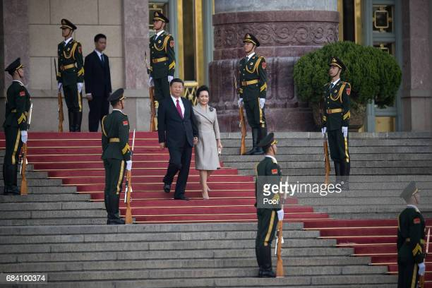 hinese President Xi Jinping and his wife Peng Liyuan walk down stairs during a welcome ceremony for Argentine President Mauricio Macri outside the...