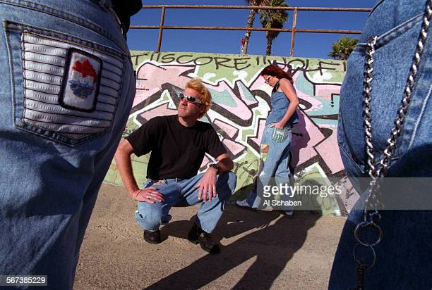 BEACH––Hinge Jeans models Ken Hodge and Stephanie Bastionell show off Hinge jeans near Goldenwest St and PCH in Huntington Beach