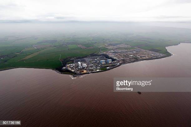 Hinkley Point B nuclear power station operated by Electricite de France SA's left stands near to groundworks for Hinkley Point C near Bridgwater UK...