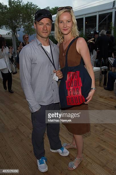 Hinnerk Schoenemann and Teresa Weissbach attend the Miranda Konstantinidou show during the MercedesBenz Fashion Week Spring/Summer 2015 at Erika Hess...